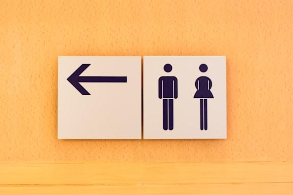 toilet sign and direction on...
