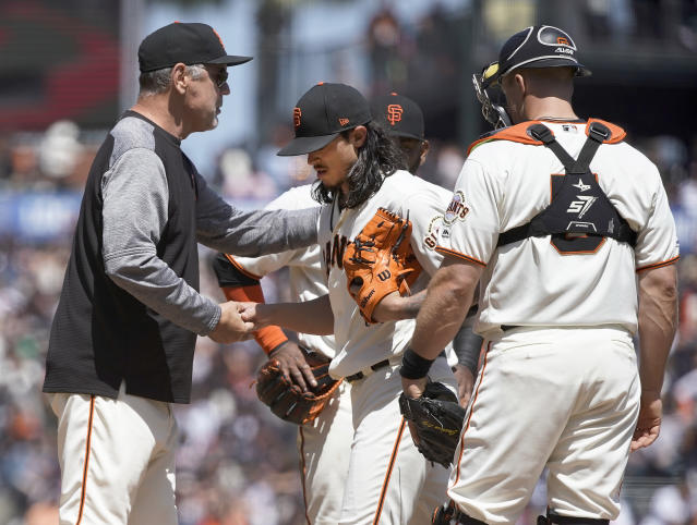 San Francisco Giants pitcher Dereck Rodriguez, center, is taken out of a baseball game by manager Bruce Bochy, left, during the fourth inning against the New York Yankees, Sunday, April 28, 2019, in San Francisco. (AP Photo/Tony Avelar )