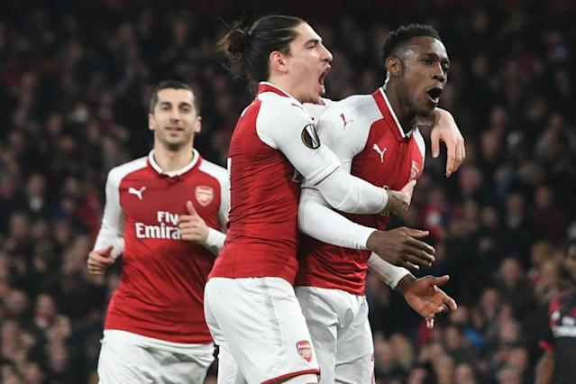 Danny Welbeck's controversial penalty and a Gianluigi Donnarumma howler helped Arsenal beat AC Milan in the Europa League last 16 on Thursday 5-1 on aggregate, while Borussia Dortmund slumped to a shock exit at the hands of Salzburg.