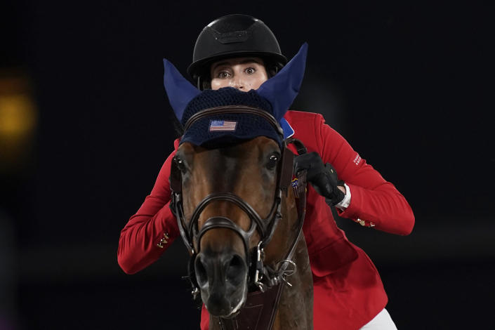 United States' Jessica Springsteen, riding Don Juan van de Donkhoeve, competes during the equestrian jumping team qualifying at Equestrian Park in Tokyo at the 2020 Summer Olympics, Friday, Aug. 6, 2021, in Tokyo, Japan. (AP Photo/Carolyn Kaster)