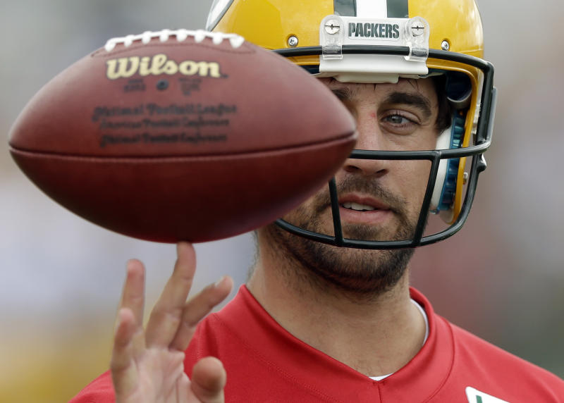 Green Bay Packers' Aaron Rodgers spins a ball on his finger during NFL football training camp Friday, July 26, 2013, in Green Bay, Wis. (AP Photo/Morry Gash)
