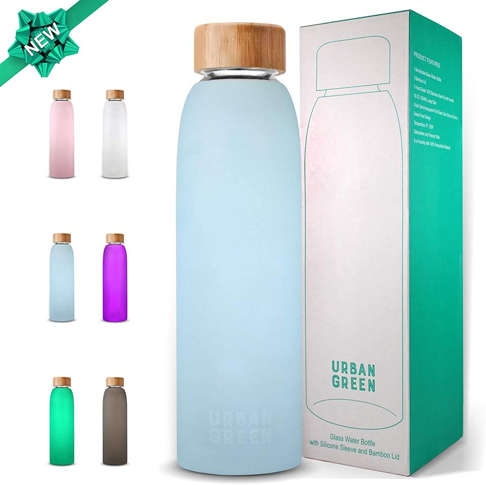 """<h2>Glass & Bamboo Reusable Water Bottle</h2><br>With its bamboo lid and protective-silicone sleeve, this top-rated reusable glass water bottle is an affordable and chic solution to cutting down on single-use plastic-bottle waste; This Urban Green fan says it's the best of both worlds: """"I like the fact that it's an attractive bottle. I use it with the screw-on top that has a strap, but the wood top is very pretty. It keeps water cold for two or three hours and it is not heavy at all. I recommend this bottle for those who are environmentally conscious, want something pretty (it comes in several colors), and is also easy to carry.""""<br><br><em>Shop <strong><a href=""""https://www.amazon.com/s?k=Urban+Green"""" rel=""""nofollow noopener"""" target=""""_blank"""" data-ylk=""""slk:Urban Green"""" class=""""link rapid-noclick-resp"""">Urban Green</a></strong></em><br><br><strong>Urban Green</strong> Glass Water Bottle, $, available at <a href=""""https://amzn.to/2FSqQc2"""" rel=""""nofollow noopener"""" target=""""_blank"""" data-ylk=""""slk:Amazon"""" class=""""link rapid-noclick-resp"""">Amazon</a>"""