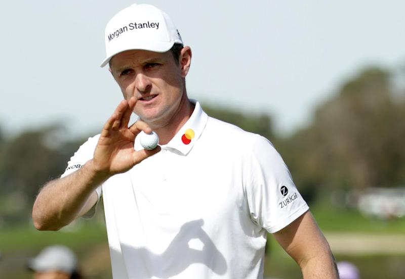 SAN DIEGO, CALIFORNIA - JANUARY 26: Justin Rose of England reacts to his birdie putt on the 11th hole on the South Course during the third round of the the 2019 Farmers Insurance Open at Torrey Pines Golf Course on January 26, 2019 in San Diego, California. (Photo by Jeff Gross/Getty Images)