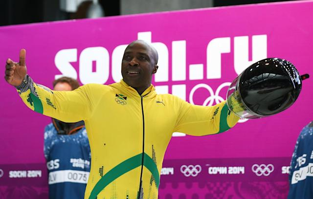 SOCHI, RUSSIA - FEBRUARY 17: Pilot Winston Watts of Jamaica team 1 salutes the crowd after he finishes a run during the Men's Two-Man Bobsleigh on Day 10 of the Sochi 2014 Winter Olympics at Sliding Center Sanki on February 17, 2014 in Sochi, Russia. (Photo by Alex Livesey/Getty Images)