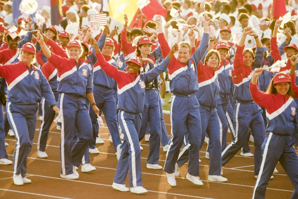 <p>The 1984 uniforms amped up the patriotism with head-to-toe red, white, and blue tracksuits, complete with bright red USA baseball hats to match. </p>