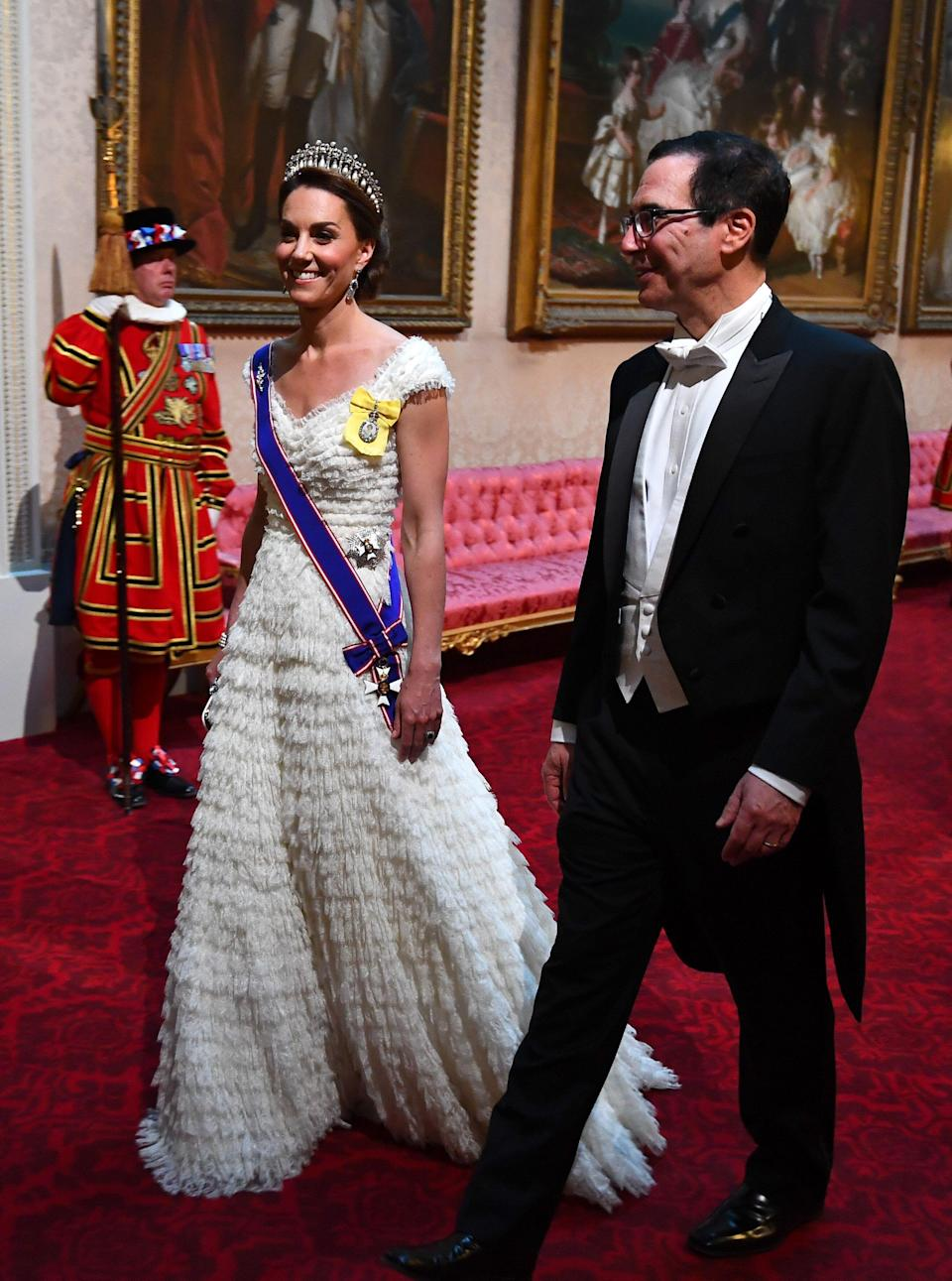 The Duchess of Cambridge and United States Secretary of the Treasury, Steven Mnuchin arrive through the East Gallery during the State Banquet at Buckingham Palace, London. [Photo: PA]