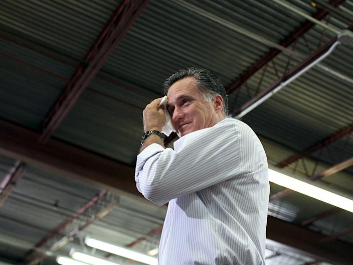 Mitt Romney wipes sweat from his face in 2012.