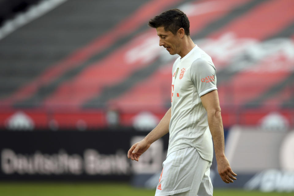 Munich's Robert Lewandowski walks on the pitch during the German Bundesliga soccer match between Eintracht Frankfurt and Bayern Munich in Frankfurt, Germany, Saturday, Feb. 20, 2021. (Arne Dedert/POOL via AP)