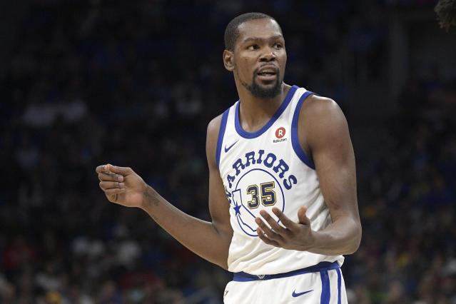 "<a class=""link rapid-noclick-resp"" href=""/nba/players/4244/"" data-ylk=""slk:Kevin Durant"">Kevin Durant</a> watched the Warriors win from the locker room Friday night. (AP Photo/Phelan M. Ebenhack)"