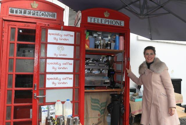 Lily Deluca, from Sao Paolo, has turned a red phone box into a mini coffee kiosk on Tunsgate in Guildford, Surrey