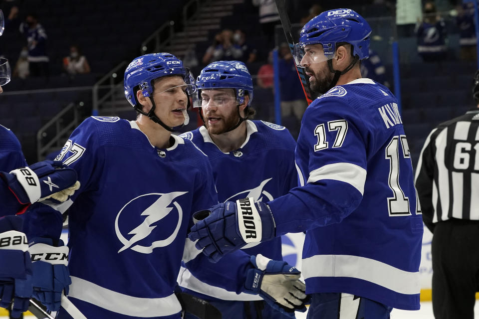 Tampa Bay Lightning left wing Alex Killorn (17) celebrates his goal against the Dallas Stars with center Yanni Gourde (37) and center Brayden Point (21) during the second period of an NHL hockey game Wednesday, May 5, 2021, in Tampa, Fla. (AP Photo/Chris O'Meara)