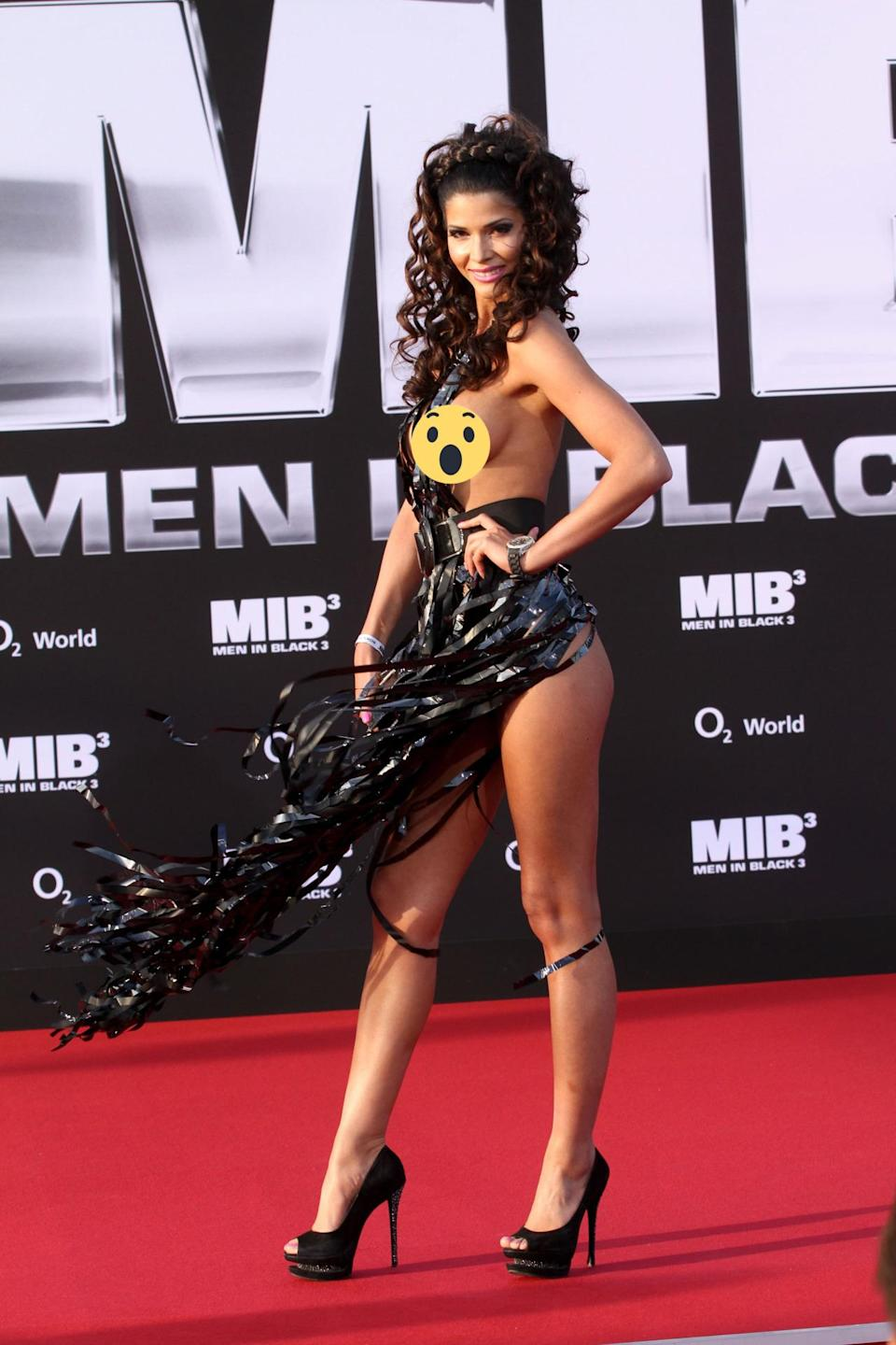 <p>At the world premiere of 'Men in Black 3′, German actress Micaela Schaefer could've done without the weird, film tape dress. After all, she showed enough skin. <i>[Photo: Getty]</i></p>