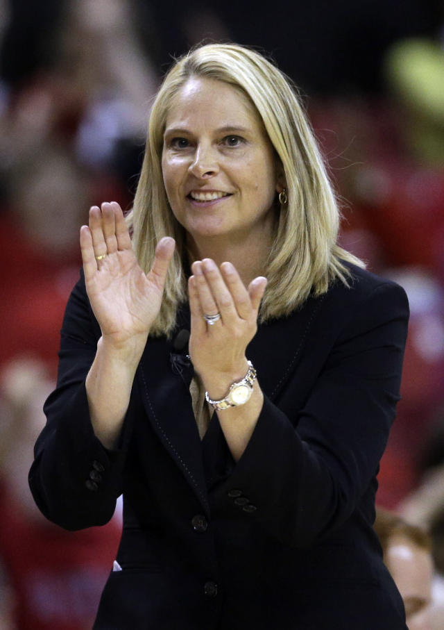 Maryland head coach Brenda Frese applauds as she watches action in the second half of an NCAA college basketball game against Ohio State in College Park, Md., Wednesday, Dec. 4, 2013. Maryland won 67-55. (AP Photo/Patrick Semansky)