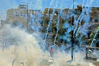 Israeli troops fire tear gas towards demonstrators during a protest in the West Bank town of Bethlehem