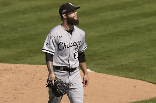 Chicago White Sox pitcher Dallas Keuchel walks to the dugout after retiring the Oakland Athletics during the first inning of Game 2 of an American League wild-card baseball series Wednesday, Sept. 30, 2020, in Oakland, Calif. (AP Photo/Eric Risberg)
