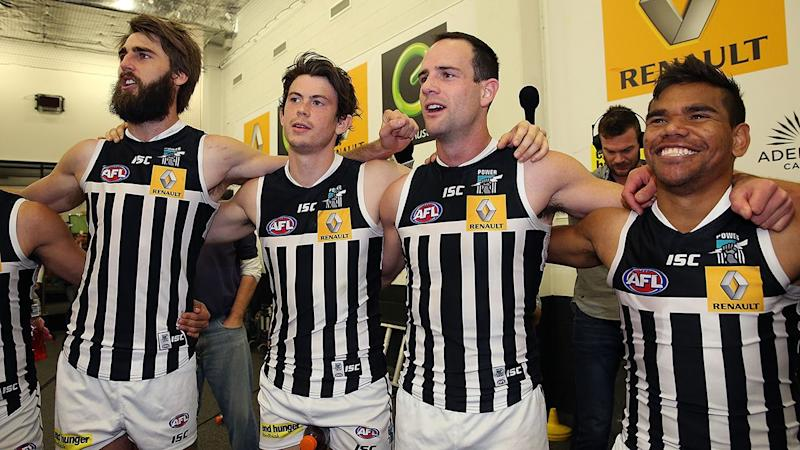 Port Adelaide players, pictured here wearing the 'prison bar' guernsey in 2014.