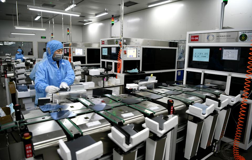 LIANYUNGANG, CHINA - JANUARY 13: An employee works on a silicon wafer inspection system at a semiconductor manufacturing enterprise on January 13, 2021 in Lianyungang, Jiangsu Province of China. (Photo by Zhang Kaihu/VCG via Getty Images)