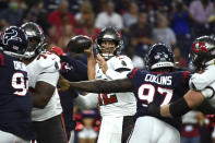 Tampa Bay Buccaneers quarterback Tom Brady (12) throws a pass against the Houston Texans during the first half of an NFL preseason football game Saturday, Aug. 28, 2021, in Houston. (AP Photo/Eric Christian Smith)