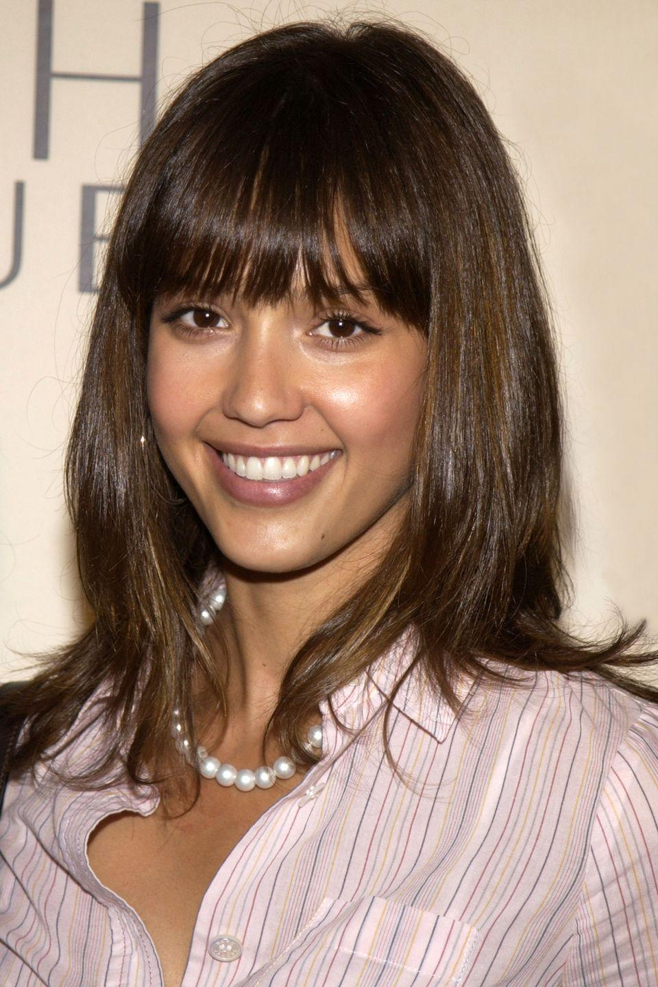 <p>Her natural hair color is a much more straightforward and solid brunette.</p>