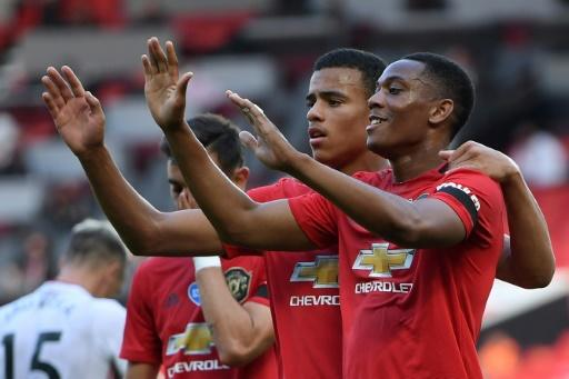 Anthony Martial (right) scored his first career hat-trick for Manchester United