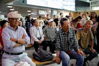 South Korean people watch a live TV broadcast on a meeting between North Korean leader Kim Jong Un and U.S. President Donald Trump at the truce village of Panmunjom inside the demilitarised zone separating the two Koreas, in Seoul