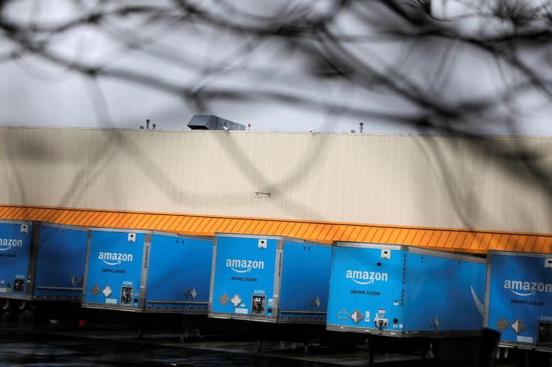 A row of trucks are parked at an Amazon facility as the global coronavirus outbreak continued in Bethpage on Long Island in New York