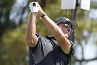 Phil Mickelson hits from the fourth tee during the second round of the Honda Classic golf tournament, Friday, March 19, 2021, in Palm Beach Gardens, Fla. (AP Photo/Marta Lavandier)
