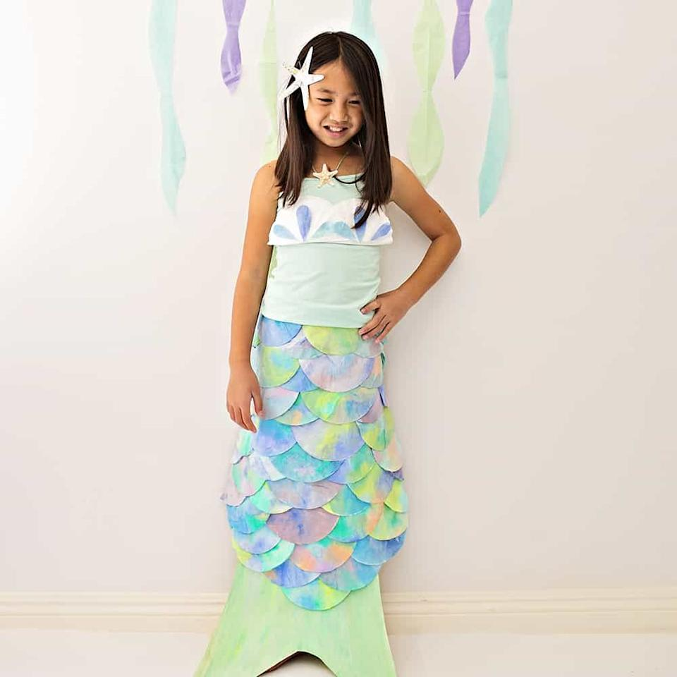 "<p>You can make your little mermaid's fishtailed fantasy become a reality by coloring coffee filters in ocean hues for an artistic, whimsical look. It's a creative costume that's sure to make waves!</p><p><strong>Get the tutorial at <a href=""https://www.hellowonderful.co/post/DIY-MERMAID-COSTUME-MADE-WITH-COFFEE-FILTERS/#_a5y_p=6534753"">Hello, Wonderful</a>. </strong></p><p><a class=""body-btn-link"" href=""https://www.amazon.com/ROCKLINE-BASKET-COFFEE-FILTERS-Filters/dp/B001UBNRH6/ref=as_li_ss_tl?tag=syn-yahoo-20&ascsubtag=%5Bartid%7C10050.g.28609960%5Bsrc%7Cyahoo-us"" target=""_blank"">SHOP COFFEE FILTERS</a></p>"