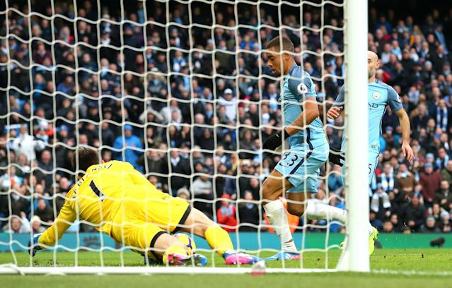 <p>Gabriel Jesus of Manchester City scores his sides second goal during the Premier League match between Manchester City and Swansea City at Etihad Stadium on February 5, 2017 in Manchester, England. </p>