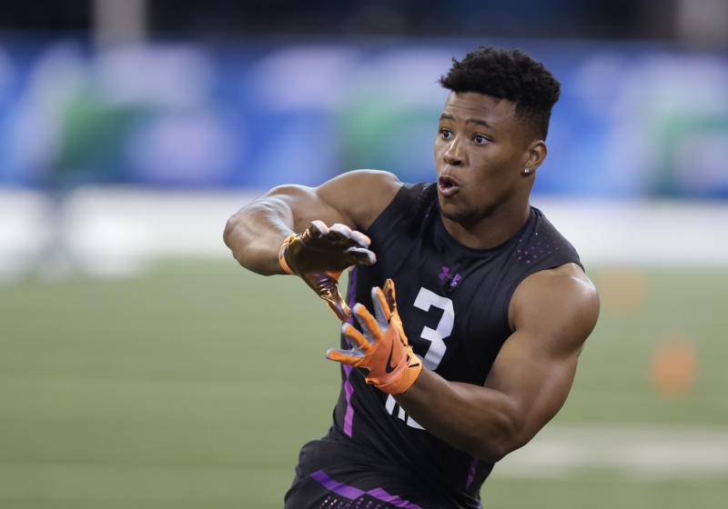 Penn State running back Saquon Barkley runs a drill during the NFL scouting combine. (AP)