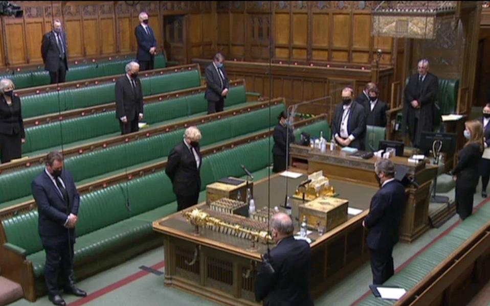 Boris Johnson and other MPs observing a minute's silence ahead of a Humble Address expressing the sympathies of the House on the death of Britain's Prince Philip - AFP via Getty