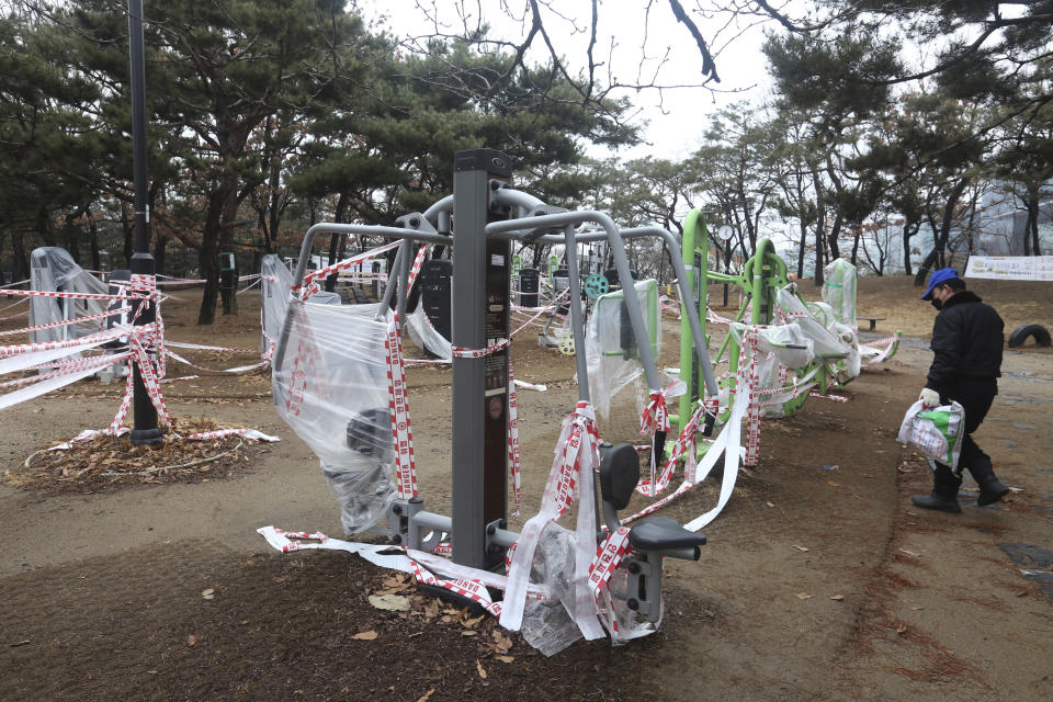 The use of public sports facilities is banned amid social distancing rules at a park in Goyang, South Korea, Friday, Jan. 22, 2021. South Korea is reporting its smallest daily increase in coronavirus infections in two months as officials express cautious hope that the country is beginning to wiggle out from its worst wave of the pandemic. (AP Photo/Ahn Young-joon)