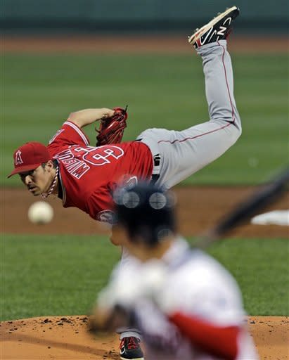 Los Angeles Angels pitcher C.J. Wilson delivers to Boston Red Sox's Jacoby Ellsbury during the first inning of a baseball game at Fenway Park in Boston, Thursday, Aug. 23, 2012. (AP Photo/Charles Krupa)