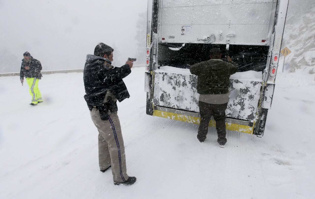 Members on the California Highway Patrol search a truck for Christopher Dorner, a former Los Angeles police officer accused of carrying out a killing spree because he felt he was unfairly fired from his job, Friday, Feb. 8, 2013, in Big Bear Lake, Calif. (AP Photo/Chris Carlson)