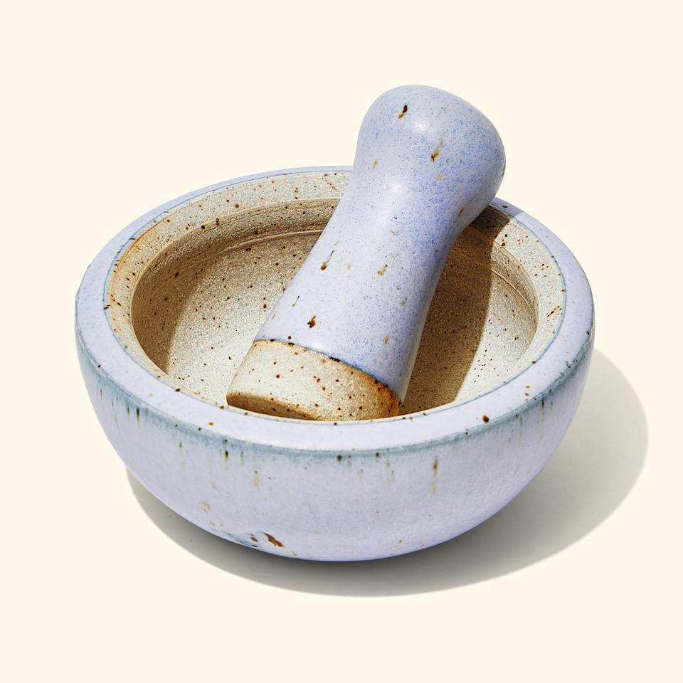 "<p>""We wanted something handmade and smaller than the average granite style. These are hand thrown by Colin Dyck out of Santa Fe and are perfect for making pesto or guacamole and just abrasive enough to grind whole spices.""</p> <p><strong>Buy it:</strong> <a href=""http://couteliernola.com/mudslide-stoneware-mortar-and-pestle-white/"" rel=""nofollow"">Mudslide Stoneware Mortar and Pestle</a>, $60</p>"