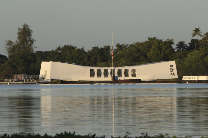 The USS Arizona Memorial is shown during a ceremony to mark the 78th anniversary of the Japanese attack on Pearl Harbor, Saturday, Dec. 7, 2019 at Pearl Harbor, Hawaii. Survivors and members of the public gathered in Pearl Harbor to remember those killed when Japanese planes bombed the Hawaii naval base 78 years ago and launched the U.S. into World War II. About a dozen survivors of the attack attended the annual ceremony, the youngest of whom are now in their late 90s. (AP Photo/Caleb Jones)