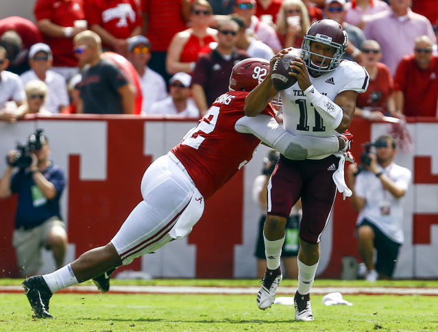 FILE - In this Sept. 22, 2018, file photo, Texas A&M quarterback Kellen Mond (11) is hit by Alabama defensive lineman Quinnen Williams (92) as he throws the ball during the first half of an NCAA college football game, in Tuscaloosa, Ala. Williams is a possible pick in the 2019 NFL Draft. (AP Photo/Butch Dill, File)