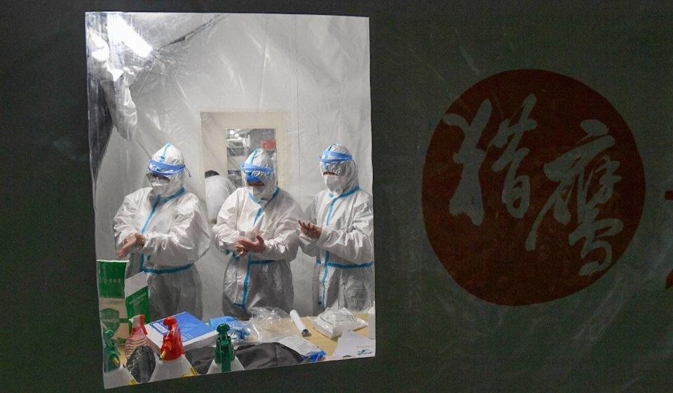 Four makeshift nucleic acid testing laboratories have been set up at a stadium in Guangzhou, each of which can process 120,000 tests a day. Photo: Xinhua