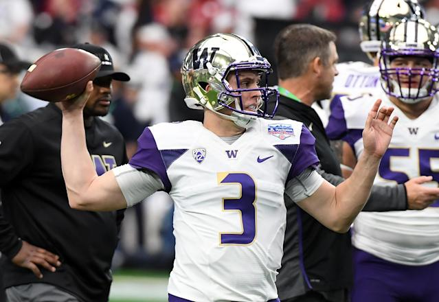 Nike will supply Washington's football uniforms for one more season. (Getty)