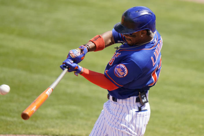 New York Mets' Francisco Lindor hits a single during the third inning of a spring training baseball game against the Houston Astros, Tuesday, March 16, 2021, in Port St. Lucie, Fla. (AP Photo/Lynne Sladky)