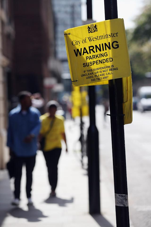 LONDON, ENGLAND - JULY 01: Parking is suspended outside the Lindo Wing of St Mary's Hospital as the UK prepares for the birth of the first child of The Duke and Duchess of Cambridge, on July 1, 2013 in London, England. (Photo by Oli Scarff/Getty Images)