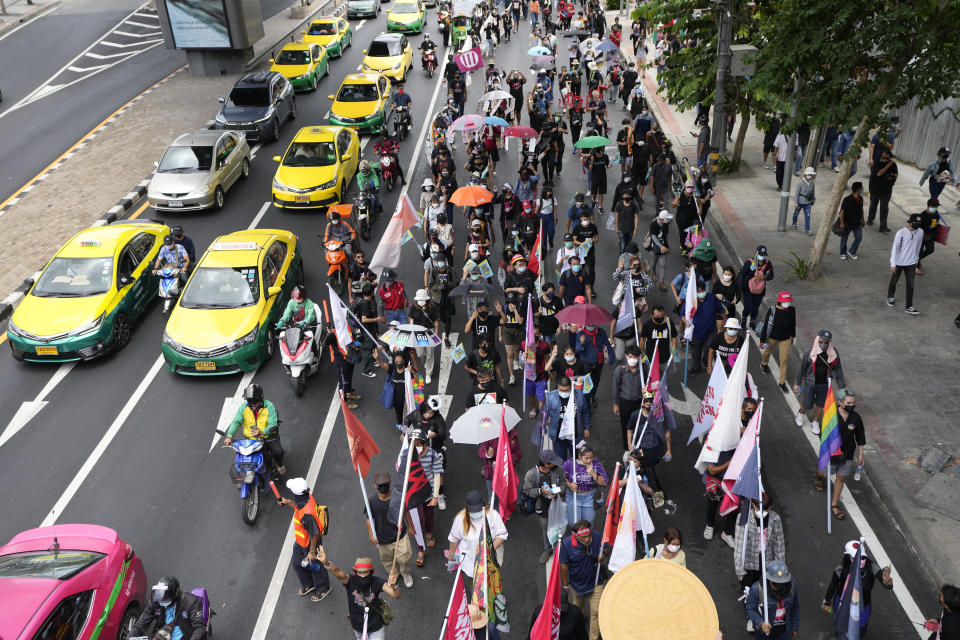 Pro-democracy supporters wearing face mask march on the road during a demonstration in Bangkok, Thailand, Thursday, June 24, 2021. Anti-government protests expected to resume in Bangkok after a long break due partly to a surge in COVID-19 cases. Gatherings are planned for several locations across the capital, despite health officials mulling a week-long lockdown in Bangkok to control a rampant virus surge. (AP Photo/Sakchai Lalit)