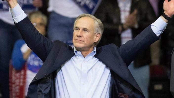 """Republican Texas Governor Greg Abbott (above) has threatened Democrats in his state who have pushed back against a GOP-sponsored bill they claim will provide """"election integrity.""""(Photo by Loren Elliott/Getty Images)"""