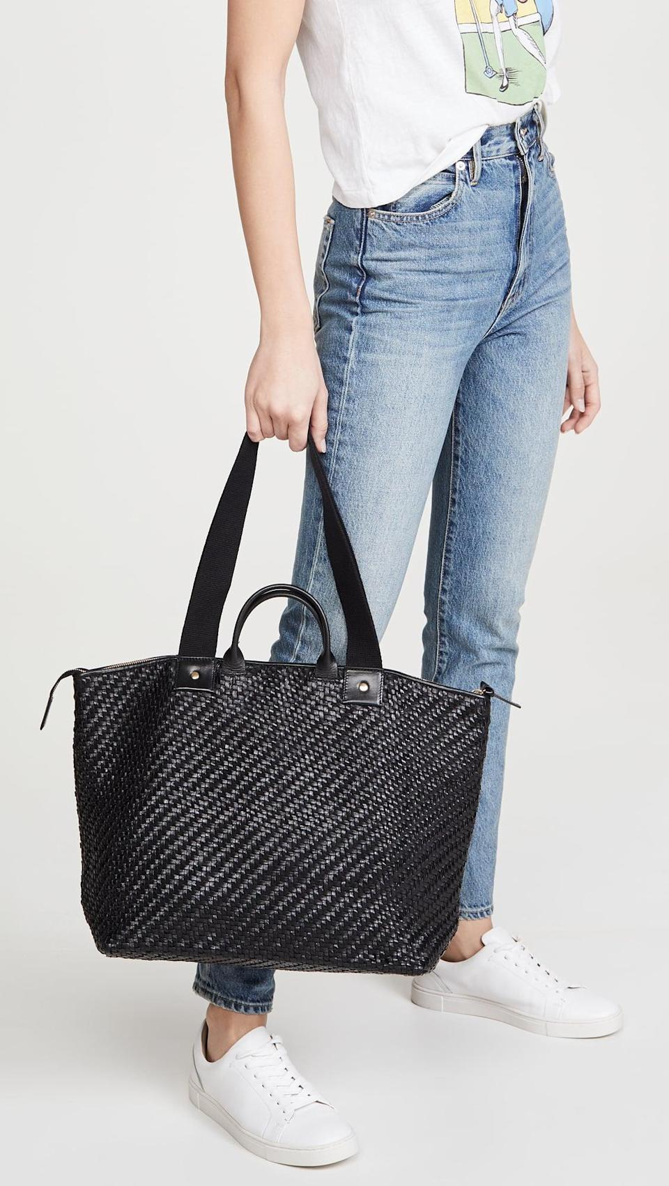 """<p>We love that this <a href=""""https://www.popsugar.com/buy/Clare-V-Le-Zip-Sac-Bag-537113?p_name=Clare%20V.%20Le%20Zip%20Sac%20Bag&retailer=shopbop.com&pid=537113&price=535&evar1=fab%3Aus&evar9=45623846&evar98=https%3A%2F%2Fwww.popsugar.com%2Ffashion%2Fphoto-gallery%2F45623846%2Fimage%2F47066452%2FClare-V-Le-Zip-Sac-Bag&list1=shopping%2Caccessories%2Cbags%2Cworkwear&prop13=mobile&pdata=1"""" class=""""link rapid-noclick-resp"""" rel=""""nofollow noopener"""" target=""""_blank"""" data-ylk=""""slk:Clare V. Le Zip Sac Bag"""">Clare V. Le Zip Sac Bag </a> ($535) has two different strap options.</p>"""
