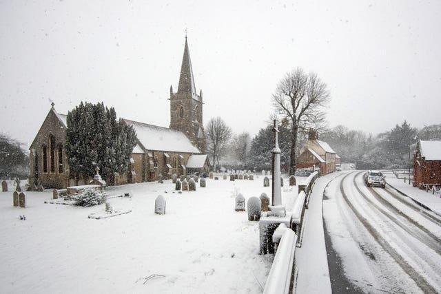 Snow falls around St Edmund King & Martyr Church in Tendring