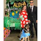 """<p>How perfect is this <em>Lilo & Stitch</em>-themed costume and trunk-or-treat look? The costume is super easy to execute and so is the tropical trunk behind them. The <a href=""""https://www.amazon.com/Pineapple-Decorations-Hawaiian-Honeycomb-Decoration/dp/B0854MHJ2K?tag=syn-yahoo-20&ascsubtag=%5Bartid%7C2089.g.33658548%5Bsrc%7Cyahoo-us"""" rel=""""nofollow noopener"""" target=""""_blank"""" data-ylk=""""slk:hanging pineapples"""" class=""""link rapid-noclick-resp"""">hanging pineapples</a> and repurposed <a href=""""https://www.amazon.com/Super-Outlet-Hawaiian-Birthdays-Celebration/dp/B01HOWZ484?tag=syn-yahoo-20&ascsubtag=%5Bartid%7C2089.g.33658548%5Bsrc%7Cyahoo-us"""" rel=""""nofollow noopener"""" target=""""_blank"""" data-ylk=""""slk:grass skirt"""" class=""""link rapid-noclick-resp"""">grass skirt</a> give this theme the right amount of island style. </p><p><a class=""""link rapid-noclick-resp"""" href=""""https://www.amazon.com/Talking-Tables-FST6-GARLAND-PALM-Tropical-Decorations/dp/B07M5BGJFV?tag=syn-yahoo-20&ascsubtag=%5Bartid%7C2089.g.33658548%5Bsrc%7Cyahoo-us"""" rel=""""nofollow noopener"""" target=""""_blank"""" data-ylk=""""slk:Shop Tropical Leaves"""">Shop Tropical Leaves</a></p>"""