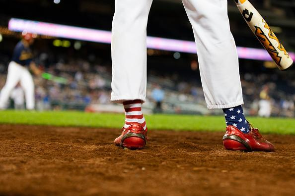 Rep. Fred Upton (R-MI) wears patriotic socks as he waits to bat during the Congressional Baseball Game on June 14, 2018 in Washington, DC. This was the 57th annual game between the Republicans and Democrats. (Photo by Alex Edelman/Getty Images)