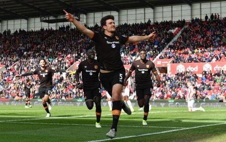 Britain Soccer Football - Stoke City v Hull City - Premier League - bet365 Stadium - 15/4/17 Hull City's Harry Maguire celebrates scoring their first goal with team mates Reuters / Anthony Devlin Livepic