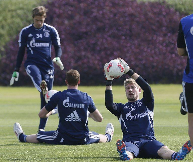Schalke goalkeeper Lars Unnerstall (right) catches a ball during a training session in Doha, Qatar on January 4, 2013