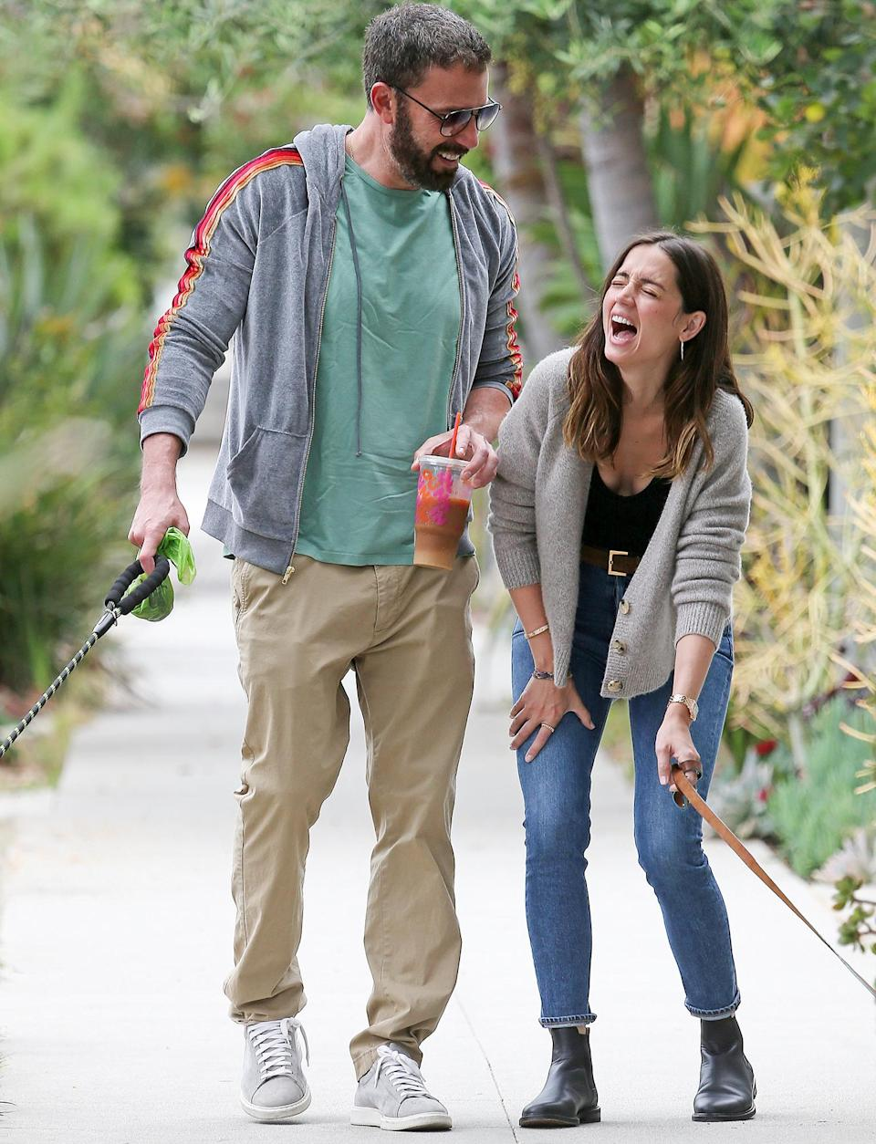 <p>Ben Affleck and Ana de Armas share a laugh on Wednesday during a walk with their dogs in L.A. </p>